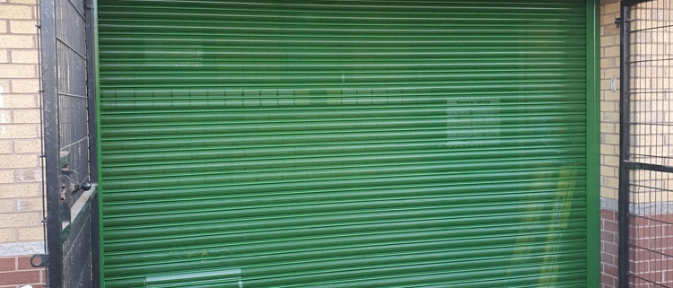 perforated green roller shutters Salford